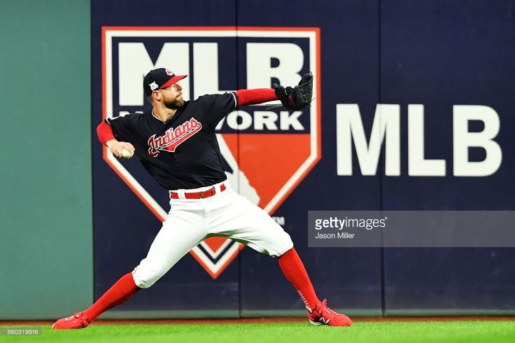 News Photo : Corey Kluber of the Cleveland Indians warms up...