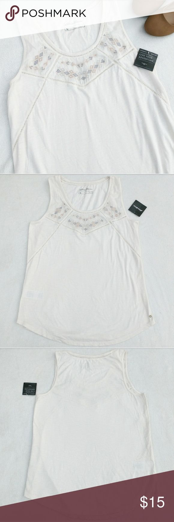 Off White Boho Bohemian Embroidered Tank Top Shirt Embroidered top by Eddie Bauer.  New with tags.  Is an off white, almost light creme colored shirt.   Has a geometric, tribal or southwestern design  embroidery along the neckline in pastels.   Has stripes of eyelet fabric.   Has a small spot on the back of the shirt, shown in the last picture, that was there when purchased.   Size medium. Eddie Bauer Tops Tank Tops