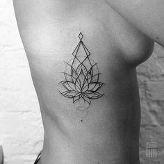Geometric Lotus Tattoo on Side.                              …