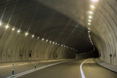 Abstract speed motion in urban highway road tunnel stock photo