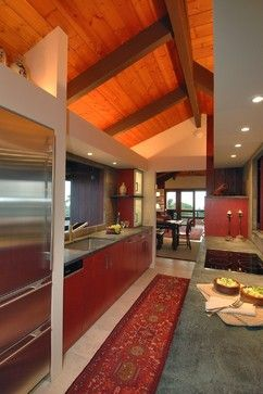 Cove lighting provide a wonderful light on this beautiful wooden ceiling.  It visually opens up a narrow space.