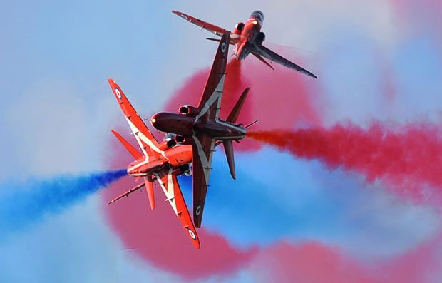"The British Royal Air Force Aerobatic Team ""Red Arrows"" perform in the skies over the Rivolto army base during an air show"