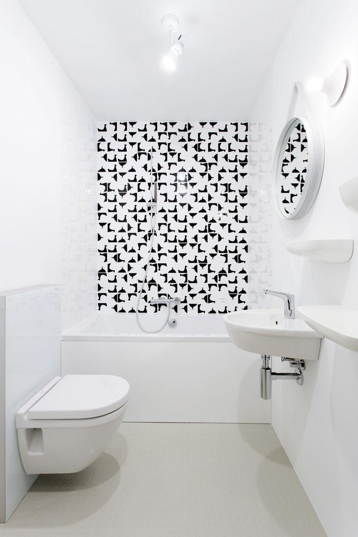 Minimalist bathroom with black and white Ceramica Bardelli tiles.