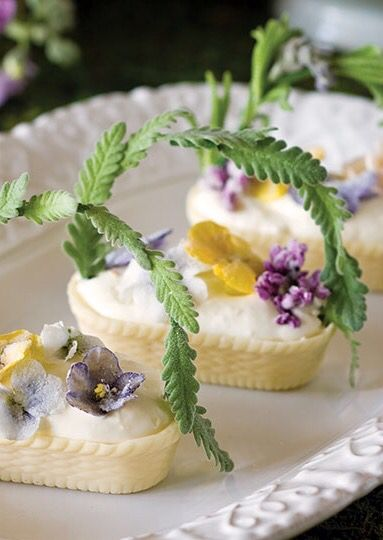 White Chocolate baskets filled with whipped cream, lemon zest, and sugared edible flowers
