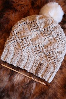 Inspired by the Nevron hat, this hat is worked in rows sideways. A little bit of lacy, a little bit of wintery at the same time. Front post stitches create cute little pinetrees on your hat :)