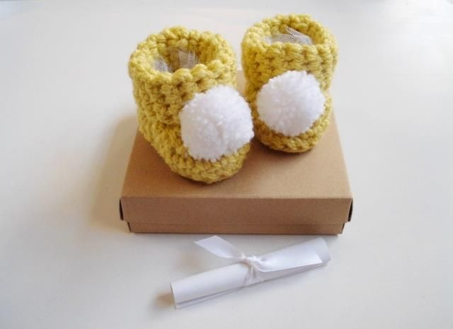Cute yellow booties with white pompom available to order now via http://ift.tt/2z98oVj