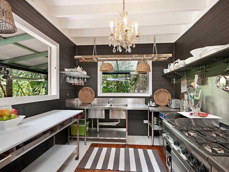 an elegant, stainless steel kitchen