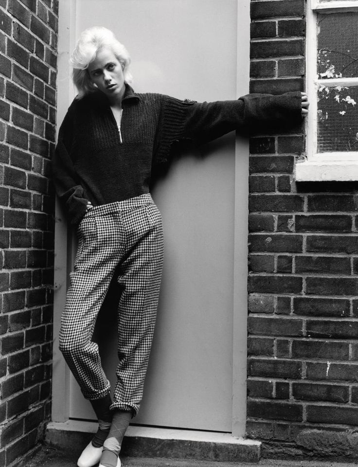 Model Marjan Jonkman wears Sweater vintage Stone Island from Massimo Osti Archive. Trousers Mulberry. Shoes Repetto. Socks Burlington. Photography Theo Sion