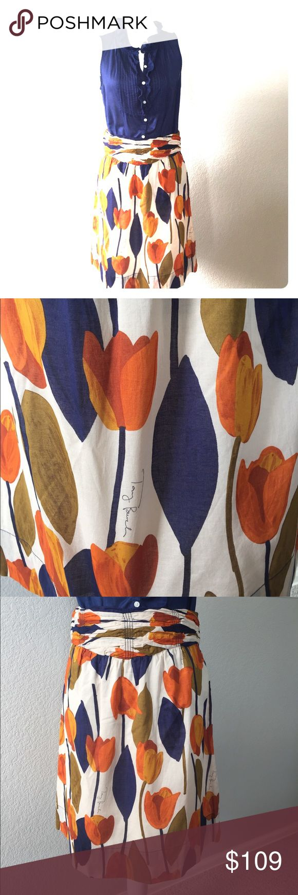 """Tory Burch Skirt Sz 6 Tory Burch Skirt, Tulip Print with Tory's signature on the print. EUC, Lightweight, 100% Cotton. Rare/HTF. Side zip with hook and eye closure. Very small, double stitch on the side hem (see pic). Cream, Oranges, Gold/brown, Indigo blues. 22.5"""" from waist to hem. Seriously adorable. Retail $295. Tory Burch Skirts Midi"""