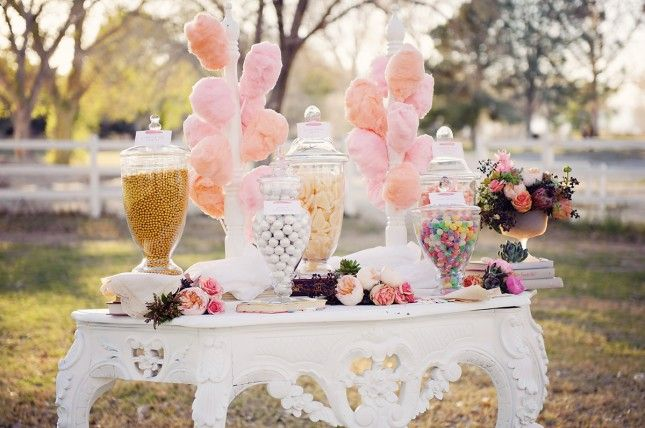 Line a romantic table with cotton candy. So sweet!