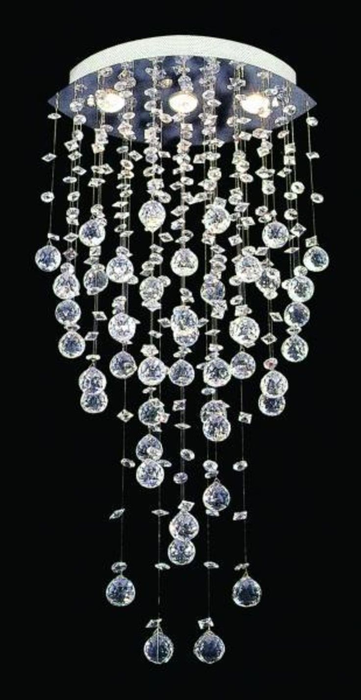 Crystal Chandelier Lighting This modern design is created by shining four lights from above on to strategically positioned crystal.