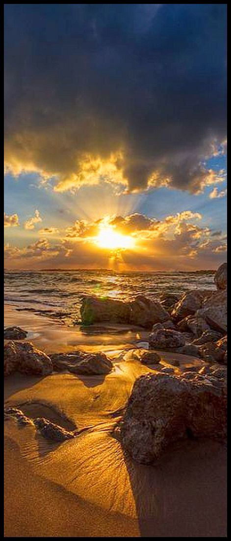 Beneath the golden skies # photo by  Sergio Gold #sky sunset sun clouds beach water lake seascape amazing nature stone sunlight