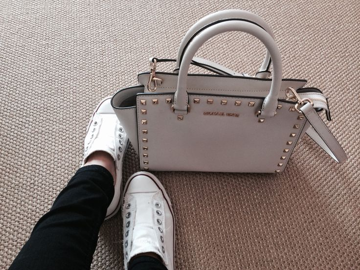 Converse sneakers and michael kors bag