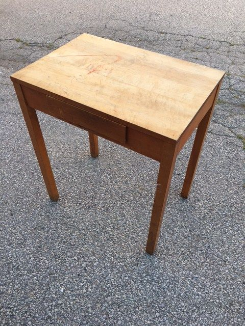 Vintage office furniture available to rent through Bygone Theatre. Small (somewhat fragile) telephone table with sliding drawer. 26″ wide, 18″ deep, 30″ tall.