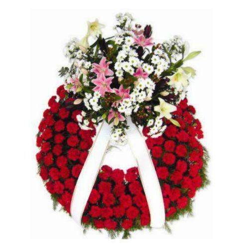 Corona de flores funeraria, aro claveles rojos y un colo cabezal de Liliums tonos rosa con margarita Blanca.