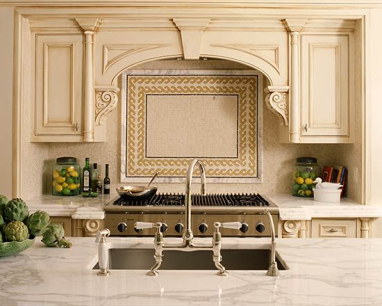 LOVE how these corbels are turned sideways. vent hood idea