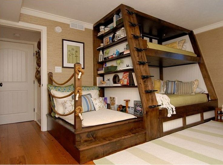 SO COOL! One day when i'm a grandma I'm making a room like this for the grandkids. Cool bunk bed idea with attached reading nook! awesome for a trio sleep over too!