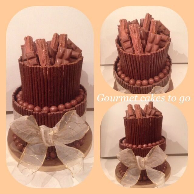 2 tier chocolate cake!! 4 layers of rich moist chocolate sponge covered & filled with smooth chocolate buttercream decorated with matchmakers, maltesers, Cadbury flake, Cadbury bars, Galaxy & Galaxy Carmel drizzles in Carmel sauce! Based in sale Manchester 07581165129