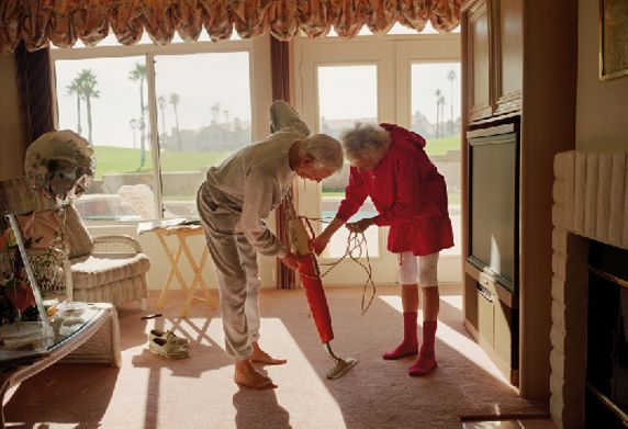 Larry Sultan // Vacuuming // 1991// This is more a natural photograph of something happening in the house. Again strong sunlight comes through.