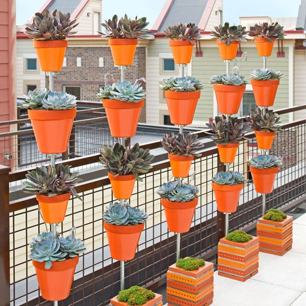 DIY Stacked Flower-Pot Planter ~ Build a space-saving tower of flowers by suspending terra-cotta pots over a concrete-block base. Make one, or create a row of them to serve as a privacy screen