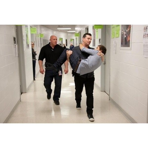 Paul Higgins carrying Liam Payne Paul Higgins ❤ liked on Polyvore featuring one direction