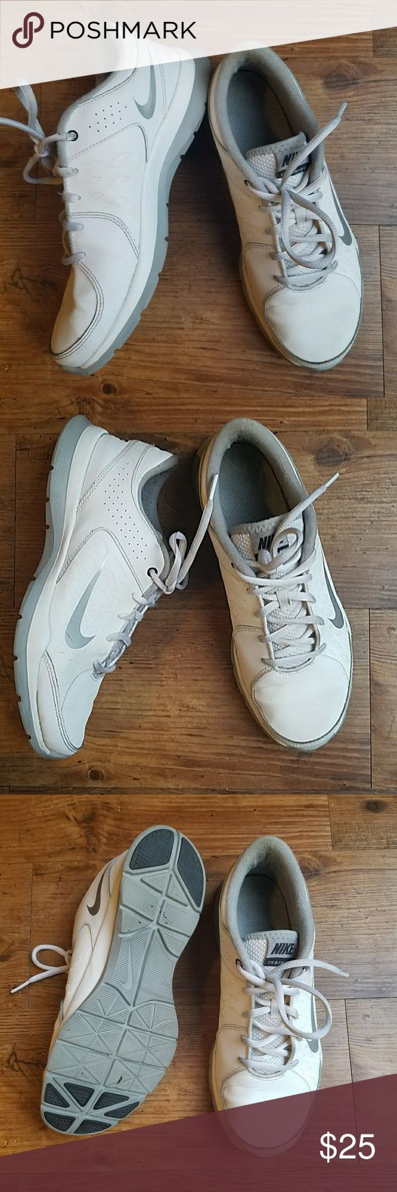 White Nike Trainers Nike tennis shoes in excellent condition. Minimal wear on bottom toe pad and inner heel (see photos). Very comfy shoes, great for constant walking. True to Nike sizing. White and grey coloring Nike Shoes Athletic Shoes