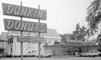 The first Dunkin' Donuts shop was opened in Quincy, Massachusetts in 1950. The company began franchising five years later. By 1963, there were over 100 Dunkin Donuts shops open and by 1979 over 1000 locations open.