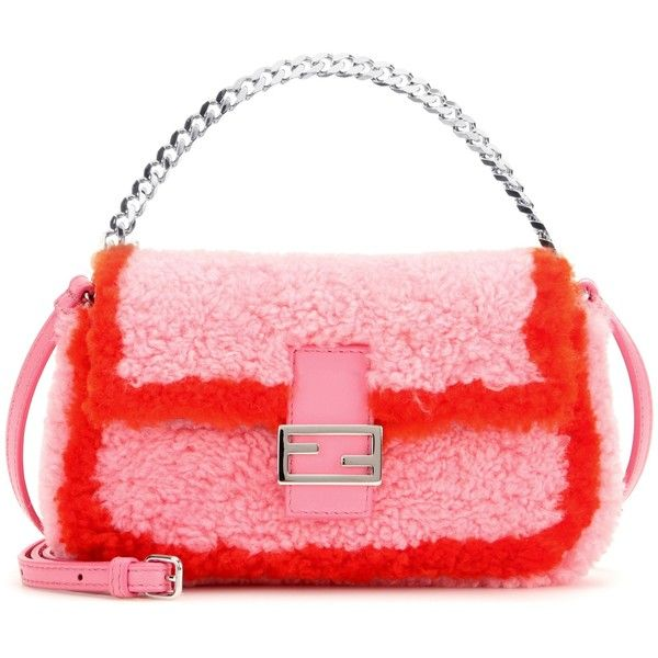 See this and similar Fendi clutches - Inject a little playful sophistication into your evening looks with this 'Micro Baguette' bag from Fendi. Covered in plush...