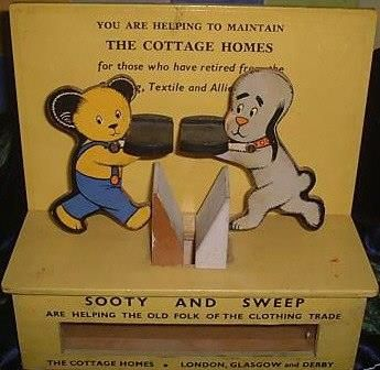 Sooty & Sweep charity box. You put the coin on the tray in sooty or sweep's hand & it dropped into the collection box.