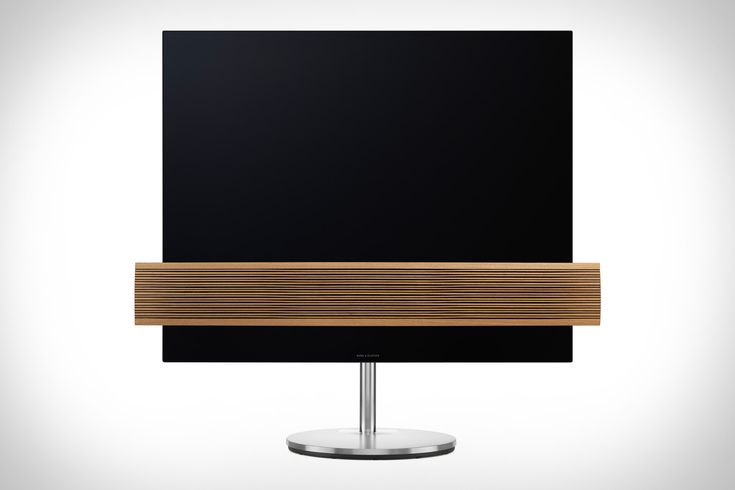 Most TVs are black monoliths. And they all blend into the same decor: none. The Bang & Olufsen BeoVision Eclipse Wood Edition TV fixes this by adhering a strip of oak between the LG-sourced OLED screen and the base, leaving...
