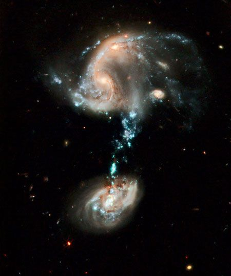 "This interacting group contains several galaxies (called Arp 194), along with a ""cosmic fountain"" of stars, gas and dust that stretches over 100,000 light-years."