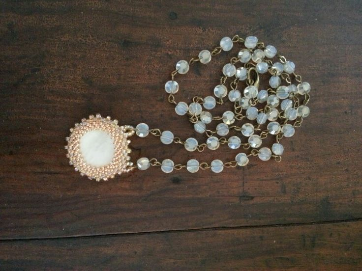 Beaded around a vintage mother of pearl button