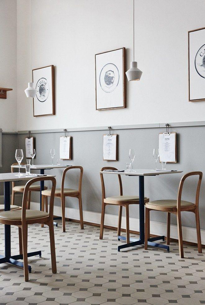 A beautiful simple scandinavian restaurant design - Finlandia Caviar, Helsinki by Joanna Laajisto, half grey walls, patterned tiled floors and minimal furniture