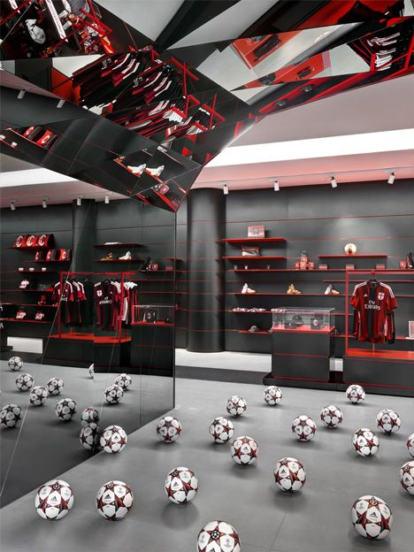AC Milan headquarters saturated its walls with company colors and its floors…