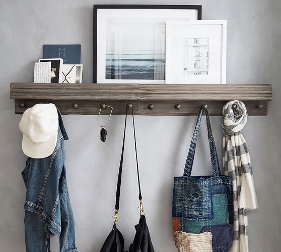 this unit from pottery barn is edged with beautiful wooden molding they fit right in like they were built for your space