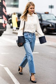 Dress up jeans with ankle-strap heels and a retro blouse (but with a modern twist, of course). x