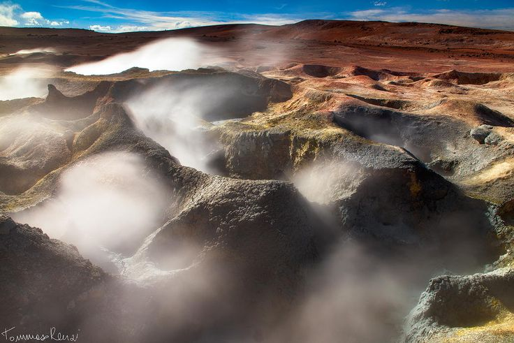 Smoking Earth - Geyser del Sol de Mañana , Bolivian Altiplano, 5000 mt Altitude Sol de Mañana, meaning Morning Sun in Spanish, is a geothermal field characterized by intense volcanic activity and the sulphur springs field,  is full of mud lakes and steam pools with boiling mud. Photography by Tommaso Renzi