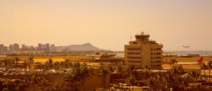 Diamond Head sprawls beyond the Honolulu International Airport in the early morning Hawaiian sun.