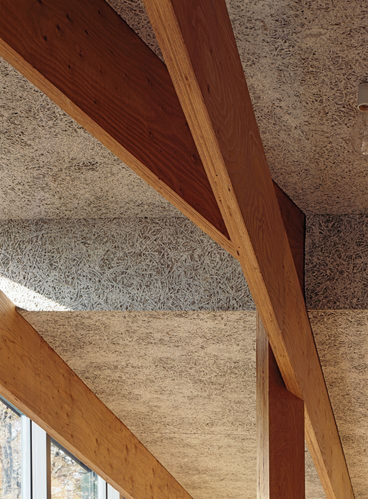 Wood-fiber cement panels by Koa Funen line the interior, and the criss-crossing laminated veneer lumber beams are from Key-Tec.