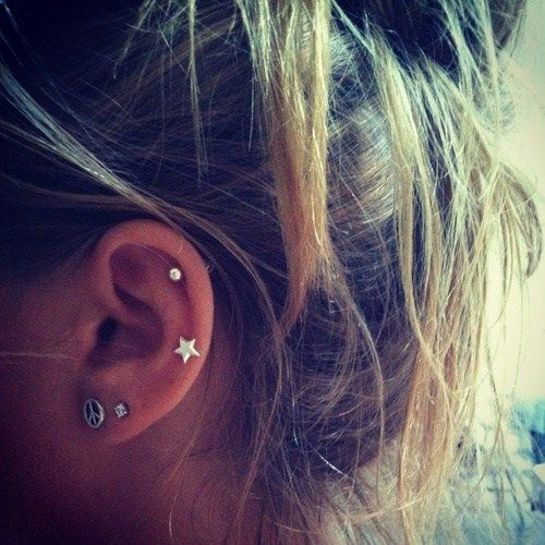 I love the idea of two cartilage piercings on one ear - It would so cool to get my cartilage pierced..