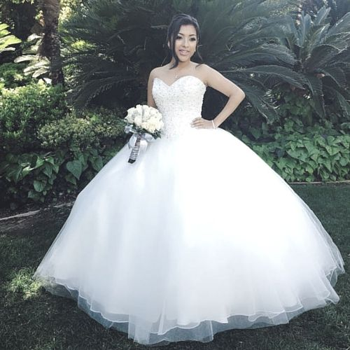 AB Virtue Studios | Find more white dress ideas here: http://www.quinceanera.com/quinceanera-dresses/