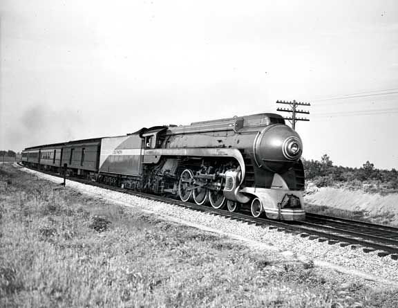 A Southern Railway streamlined steam locomotive (1380) is ...