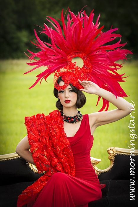 Red feather and lace avant guarde headpiece