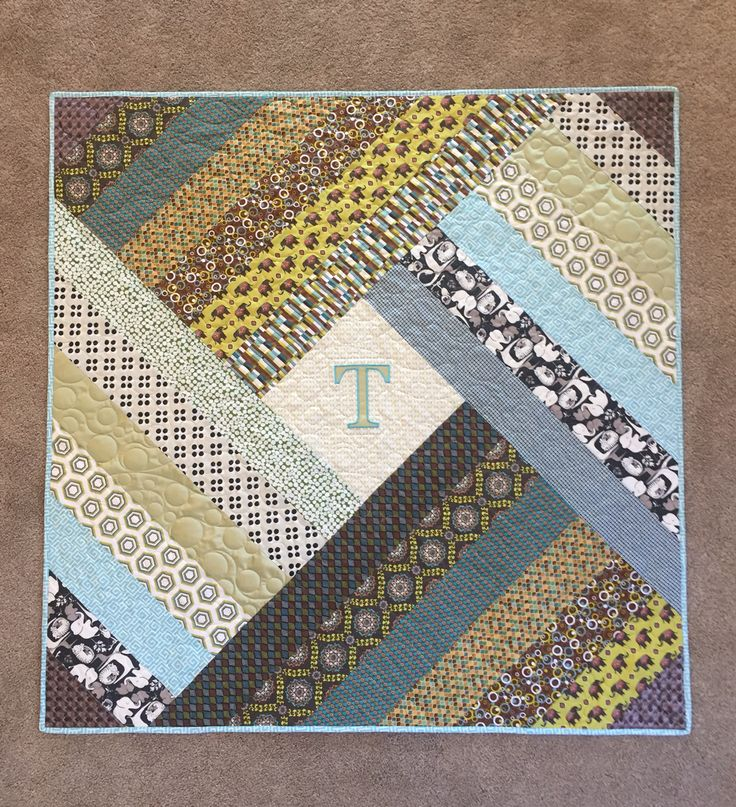 Gender-neutral baby quilt by JLB Custom Quilts (can you spot the bridesmaid dress and the grandfathers tie used in this quilt?)