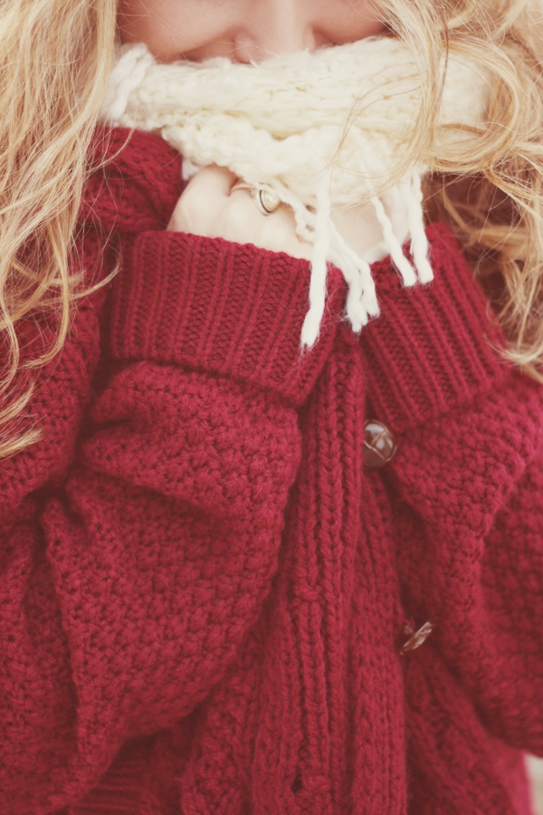 cozy red knit cardigan with wooden buttons.