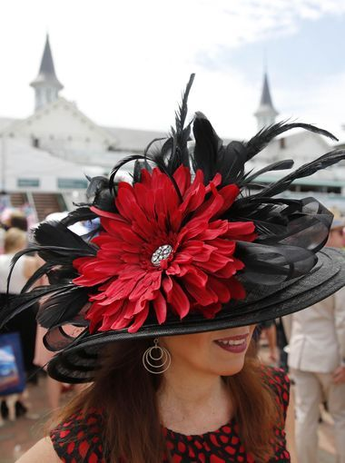 May 7, 2016; Louisville, KY, USA; A woman in a derby