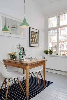 dining: mint green pendant lamp, white + wood