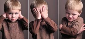 Cute ADHD boy in three poses: hands to his ears, hands over eyes, hands wrapped around himself. // sensory processing disorder SPD or ADHD