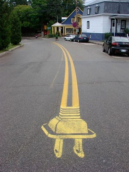 """Peter Gibson (aka Roadsworth) began painting the streets of Montreal in the fall of 2001. He was motivated by a desire for more bike paths in the city and a questioning of """"car culture"""" in general."""