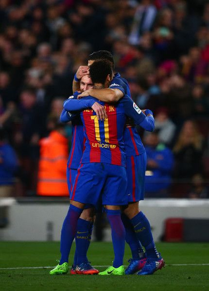 Lionel Messi of Barcelona celebrates with Neymar and Luis Suarez after scoring his team's fifth goal during the La Liga match between FC Barcelona and RC Celta de Vigo at the Camp Nou on March 4, 2017 in Barcelona, Catalonia.